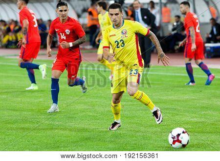 CLUJ-NAPOCA, ROMANIA - 13 JUNE 2017:Nicolae Stanciu of Romania vies the ball during the Romania vs Chile friendly, Cluj-Napoca, Romania - 13 June 2017
