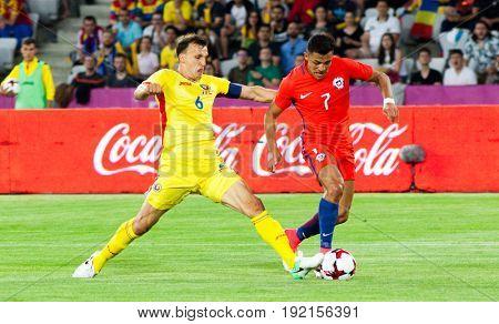 CLUJ-NAPOCA, ROMANIA - 13 JUNE 2017:Vlad Chiriches (L) of Romania in action against Alexis Sanchez of Chile during the Romania vs Chile friendly, Cluj-Napoca, Romania - 13 June 2017