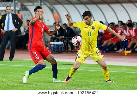 CLUJ-NAPOCA, ROMANIA - 13 JUNE 2017:Enzo Roco (L) of Chile fights the ball with Andrei Ivan of Romania during the Romania vs Chile friendly, Cluj-Napoca, Romania - 13 June 2017