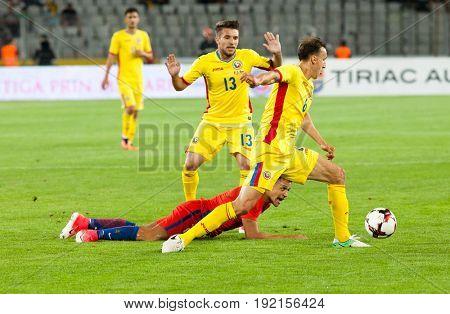 CLUJ-NAPOCA, ROMANIA - 13 JUNE 2017:Romania's Vlad ChiricheÈ? (L) in action during the Romania vs Chile friendly, Cluj-Napoca, Romania - 13 June 2017