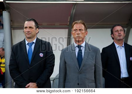 CLUJ-NAPOCA, ROMANIA - 13 JUNE 2017:Juan Antonio Pizzi, Chile's coach and Christoph Daum, Romanian national football team head coach during the national anthems ahead of the Romania vs Chile friendly,