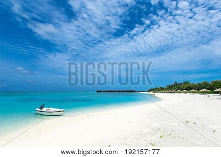Beautiful tropical Maldives island with beach
