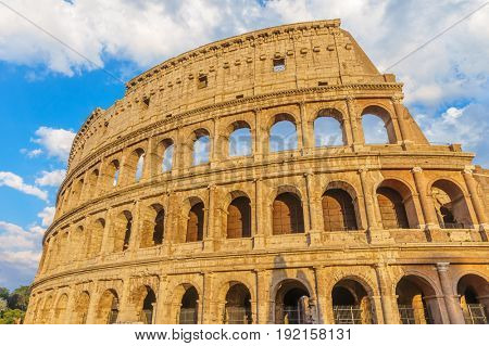 The Colosseum or Coliseum amphitheatre at sunset in the center of Rome, Italy.