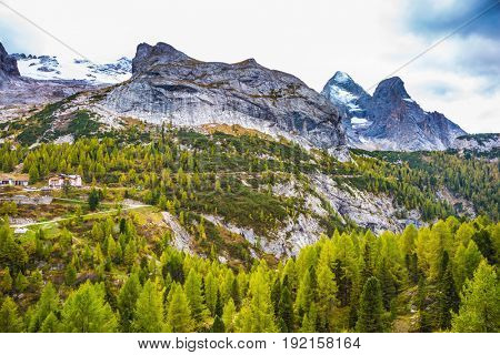 A cool autumn day at Mount Marmolada, Dolomites. The concept of ecological and extreme tourism
