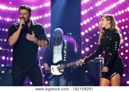AUSTIN, TX - APRIL 30: Chris Young (L) and Cassadee Pope perform during the 2016 iHeartCountry Festival at The Frank Erwin Center on April 30, 2016 in Austin, Texas.