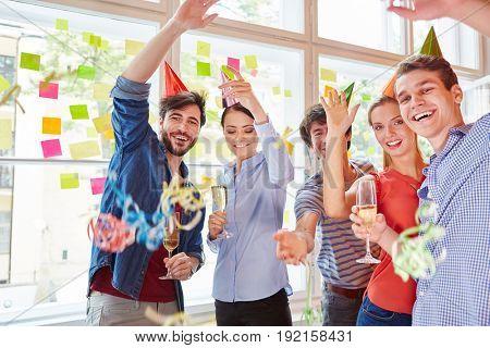 Students having fun celebrating carnival in start-up