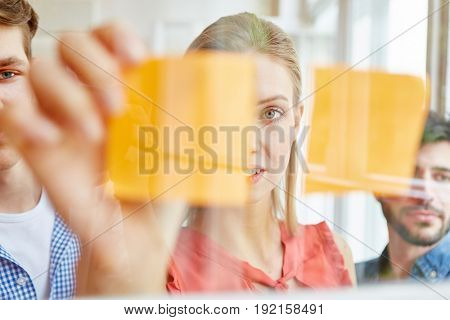 Start-up team planning with sticky notes in a business workshop