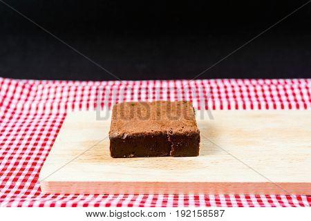 Chocolate Brownie cake on a dark plate
