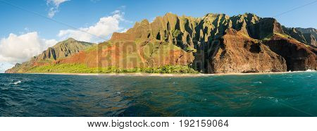 Kalalau Beach at the end of the trail on Na Pali coastline in Kauai from sunset cruise