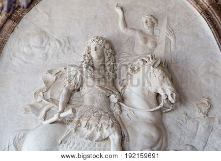 Paris, France, March 28 2017: Bas relief king Louis XIV at Versailles Palace.