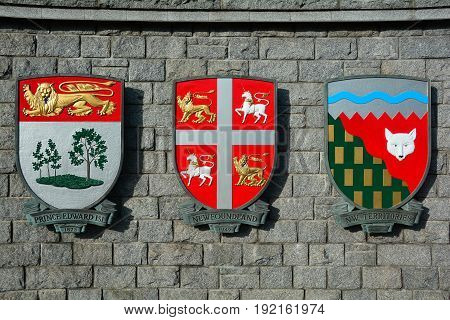 Victoria BC Canada,January 23rd 2017.The coats of arms for the Canadian provinces of Prince Edward island,Newfoundland and the Northwest Territories hang on a wall in Victoria BC,Canada