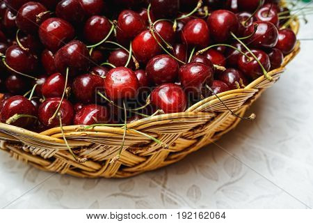 a lot of fresh cherries in a basket