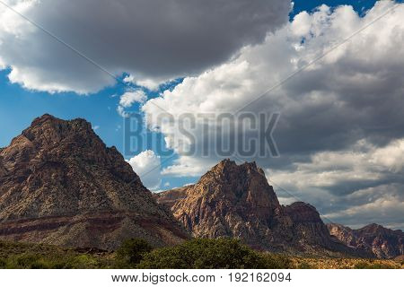 Mountains in the Mojave Desert with Blue Sky and fluffy clouds