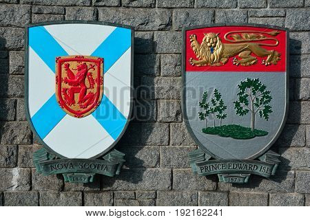 Victoria BC,Canada,January 23rd 2017.The coats of arms for the Canadian provinces of Nova Scotia and Prince Edward island hang from a wall in Victoria BC,Canada.