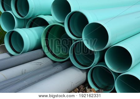 Stack of PVC pipe at a construction site