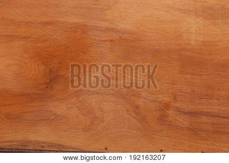 Sheet mahogany veneer plywood closeup background showing timber grain