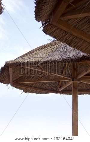 Thatched umbrellas on the beach. Summer vacation concept.