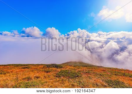 Clouds cover mountain tops at autumn day time. Caucasus. Russia.