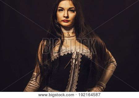 Seductive old-fashioned lady in corset over black background