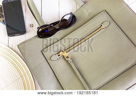 Womens mobile shopping during summer vacation .