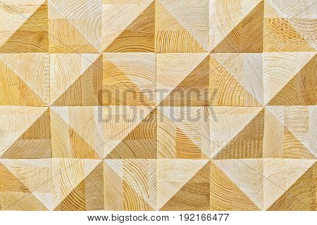Abstract decorative ecological unpainted light wooden background with geomethrical mosaik wood pattern close-up, natural surface. Wood background texture.