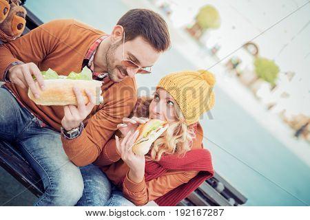 Happy loving couple enjoying breakfast in the city.