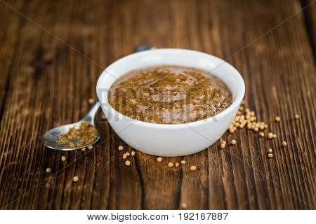 Fresh Made Mustard (sweet) On A Rustic Background