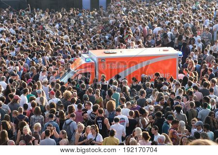 Emergency Transporter / Ambulance Inside Crowd Of People