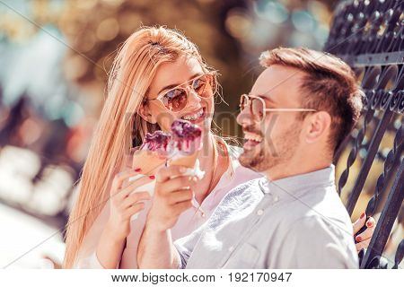 Happy young couple having fun outdoors and smiling.Summerholidays love romance and people concept.