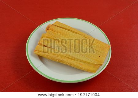Chicken and jalapeno tamale on white plate
