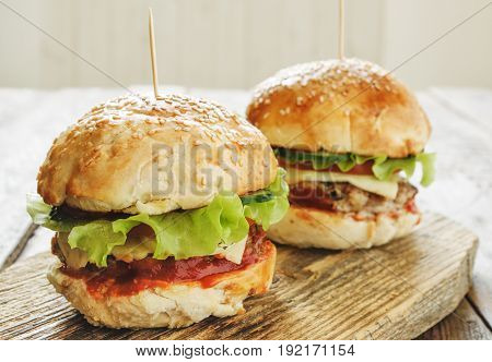 Burgers On Wooden Cutting Board