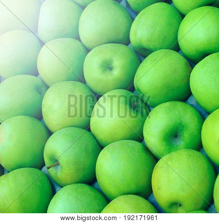 Green apples grown for sale, packed tightly