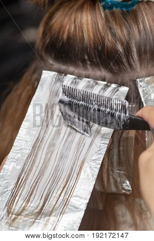 weave hair in a beauty salon, hair color