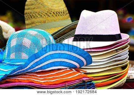 A set of hats headgear. Straw hats and women's summer hats