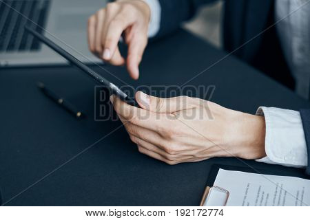 Businessman working behind a tablet, businessman with a tablet, businessman working.
