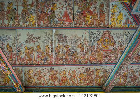 BALI, INDONESIA - MARCH 08, 2017: Scenes of Hinduist hell from Ramayana on Royal Palace, Ramayana is a Hindu epics, base of the Hindu religion, in Indonesia.