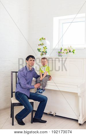 Family, children and fatherhood concept - Father and son having a good time.