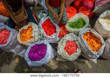 Outdoor Bali flower market. Flowers are used daily by Balinese Hindus as symbolic offerings at temples, inside of colorful baskets.