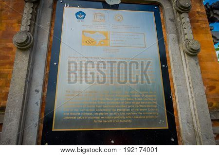 BALI, INDONESIA - MARCH 08, 2017: Informative sign of the Royal temple of Mengwi Empire located in Mengwi in Bali, Indonesia.