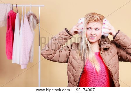 Blonde Woman In Winter Earmuffs And Jacket.