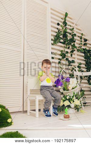 Surprised child boy with piece birthday cake.