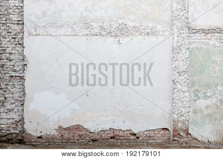 Broken old white plaster brick wall background