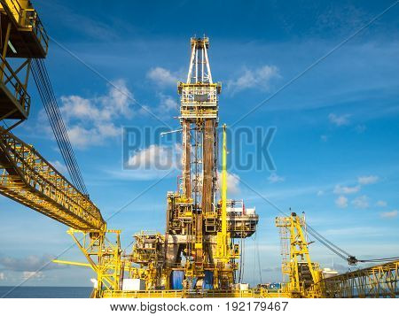 Derrick of Tender Assisted Drilling Oil Rig (Barge Oil Rig) on The Production Platform on Sunny Day