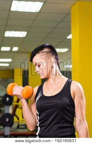 Closeup on fitness woman workout with dumbbell. fitness woman orange dumbbell