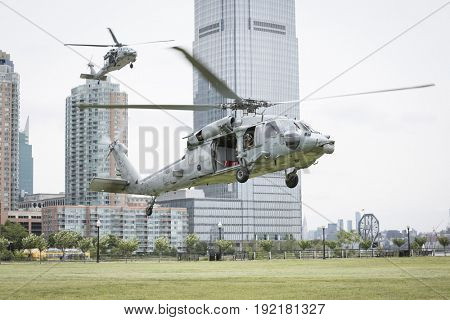 U.S. Navy MH-60S Sea Hawk helicopters hover above Liberty State Park before U.S. Navy EOD team HSC-5 Nightdippers conduct a fast rope demonstration during Fleet Week 2017, JERSEY CITY NJ MAY 28 2017