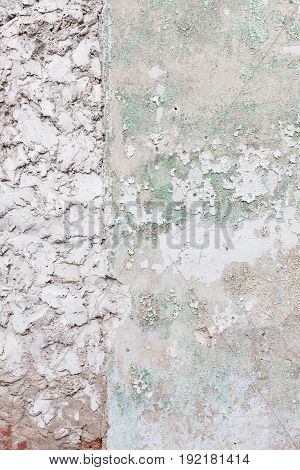 Aged white concrete wall with cracked plaster background