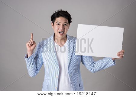 Portrait of an Asian business man holding a whiteboard