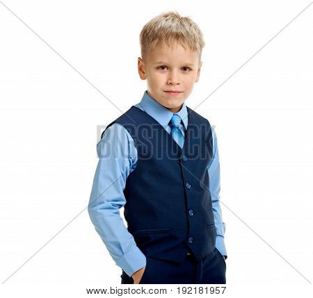 Little boy in school uniform holding hands in pockets