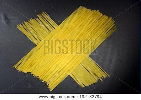 Beam of Italian pasta on a black background