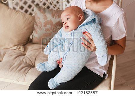 2 month old newborn mixed race Asian Caucasian boy. Natural indoor lighting. Cool tones.
